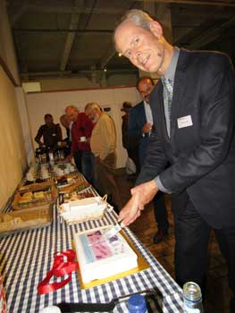 Cutting the birthday cake at the conference